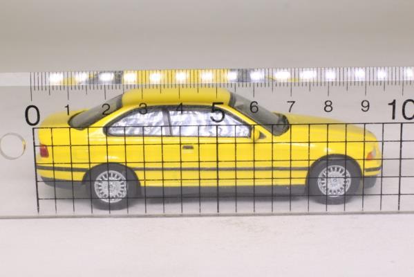 Minichamps 430 023321; 1992 BMW 3 Series (E36) Coupe, Yellow