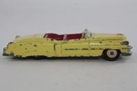 Dinky Toys 131; Cadillac Eldorado; Yellow, Cerise Seats, Cream Painted Hubs, Grey Driver