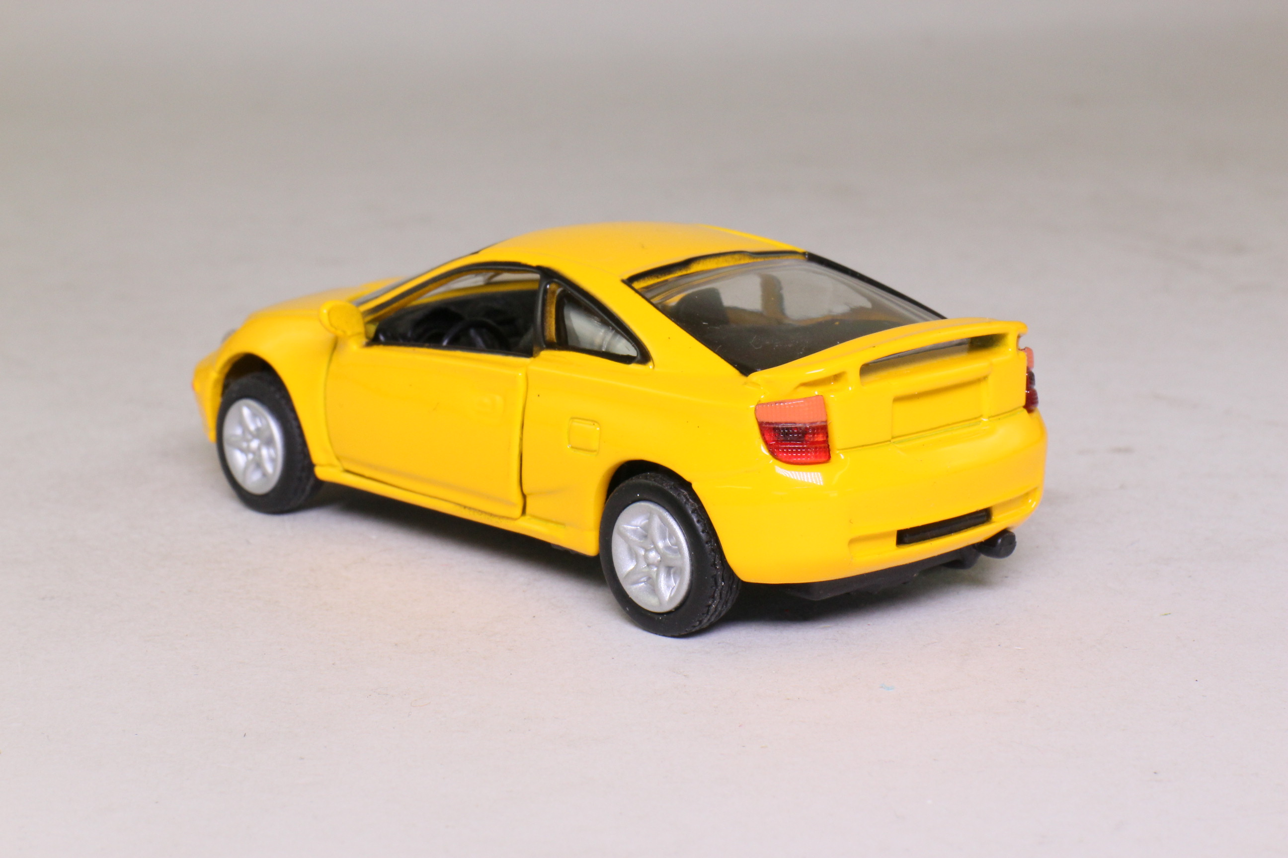 1999 toyota celica metallic yellow 1 43 scale very good. Black Bedroom Furniture Sets. Home Design Ideas